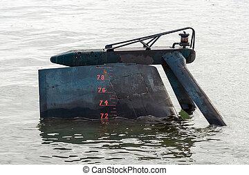 Close-up view of submarine rudder.