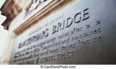 Close up 4k video of the Blackfriars Bridge commemorative plaque and focusing on the word Bridge