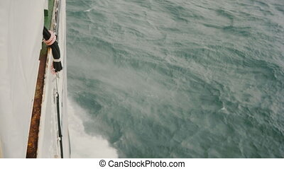 Close-up view of the board of the motorboat. White ship...