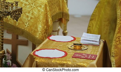 Close up view of wedding altar in orthodox church. Priest is...