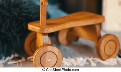 close up view of wooden kids bicycle