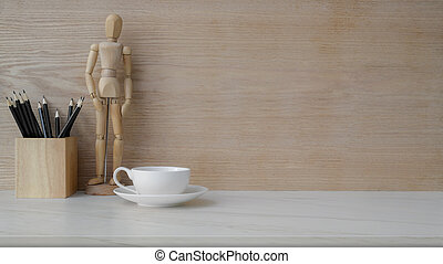 Close up view of workplace with copy space, coffee cup and decorations on marble desk