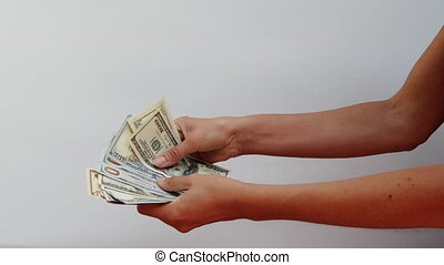 Close-up view of young female hands that are counting dollar and euro bills. The girl is holding a bundle of money in banknotes of 100 dollars and 50 euros. Good salary in dollars and euros. Big cash.