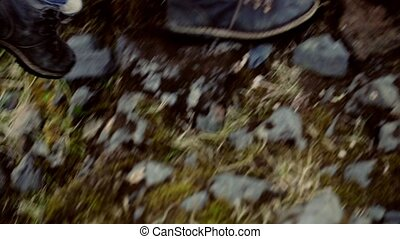Close-up view of young traveling woman with camera hiking in...