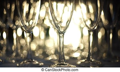 Close-up view on a set of empty glasses with reflections.