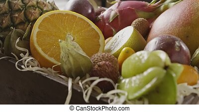 Close up view on a wooden box with fresh exotic fruits....