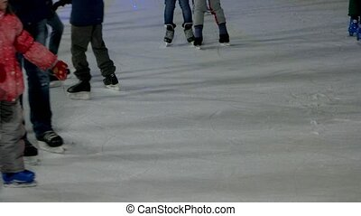 Close-up view on an ice rink. Crowded ice rink.
