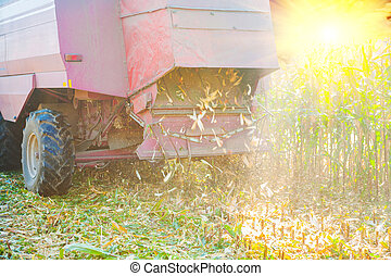 close up view on combine harvester in time of harvesting...