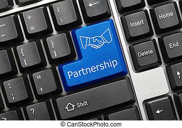 Close up view on conceptual keyboard - Partnership (blue key with handshake symbol)