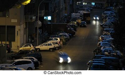 Close-up view on heavy vehicle traffic at street of Rome at night