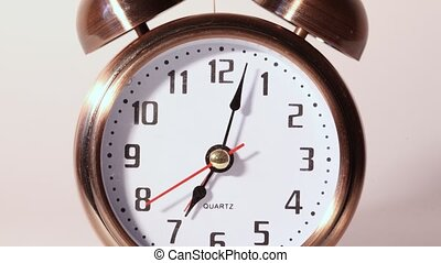 Close-up view on metal ringing alarm clock