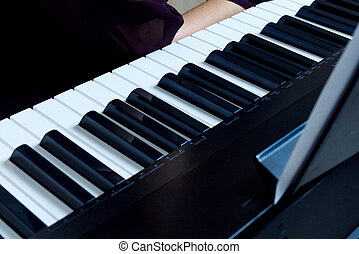 Close-up view on piano keyboard.