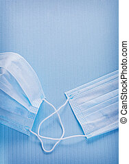 close up view on surgical mask blue background medical concep