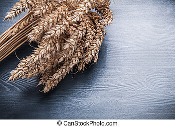 close up view rye ears on vintage wooden board