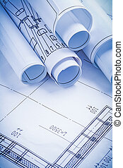 close up view stack of white construction blueprints