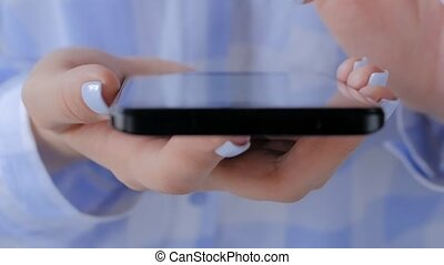 Close up view - woman using smartphone with touchscreen display