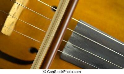 Close up violin playing - Playing the violin close up bow...