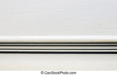Close up wall with baseboard moulding,interior background.