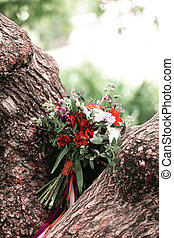wedding bouquet on the branches of a large tree
