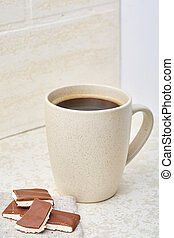 Close-up white cup of coffee with chocolate on white background, top view