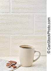 Close-up white cup of coffee with chocolate on white background.