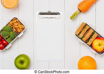 Close up white Lunch box on work place of working desk ,Healthy eating clean food habits for diet and health care concept