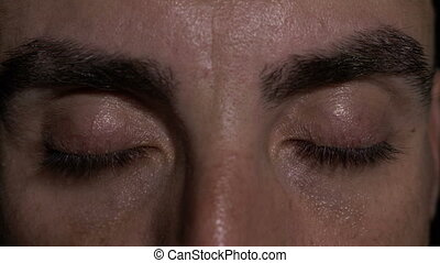 Close up with eyes of man showing surprise