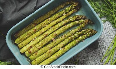 Close up with selective focus on roasted asparagus seasoned ...