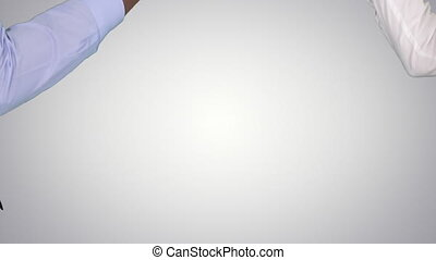 Woman and man doign the paper, scissors, rock game on gradient background.