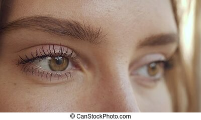 Close up woman face with brown eyes
