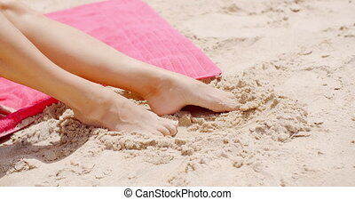Close up Woman Feet Resting on Beach Sand