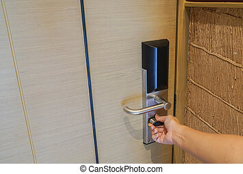 close up woman hand lock the entrance hotel room for safety