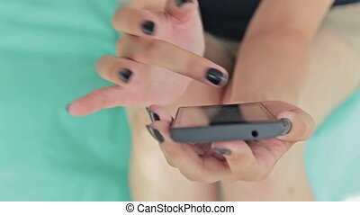 Close-up woman hands using smartphone