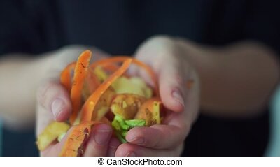 Close up woman hands with handful of vegetable peels. Composting concept. Circular economy. Eco friendly