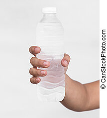 Close up Woman holding bottle of drinking water