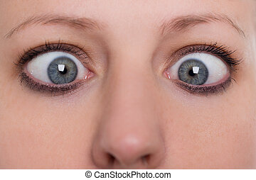 close up, woman is squinting, concept strabismus and squint