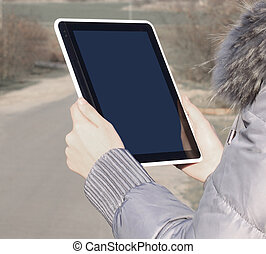 close up. woman using digital tablet outdoor