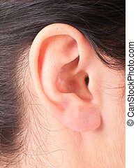 Close-up woman's ear
