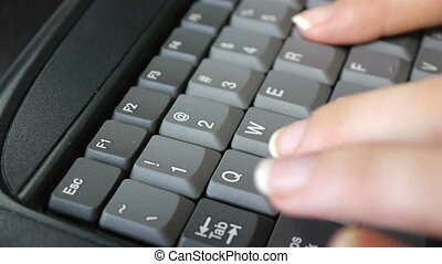 Close up woman's fingers typing