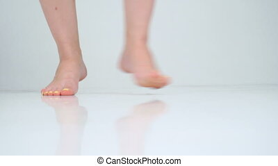 Close up women's bare feet dancing