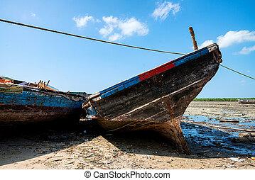 Close up wooden fishing boats on shore in Zanzibar