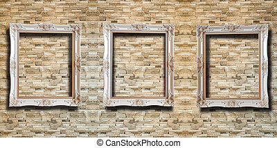 Close up wooden picture frame on red rustic brick