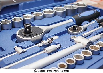Close-up wrenches in a tool case. Chrome plated wrenches.