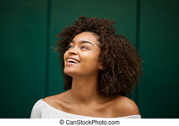 Close up young african american woman smiling and looking up
