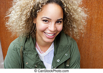 Close up young african american woman smiling