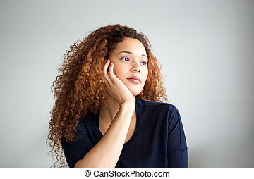 Close up young african american woman thinking and looking away