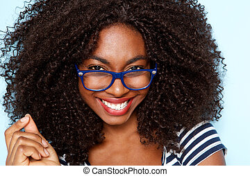 Close up young african american woman with curly hair wearing glasses