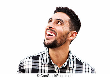 Close up young arabic man laughing against white background