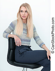 close up. young business woman sitting on a chair