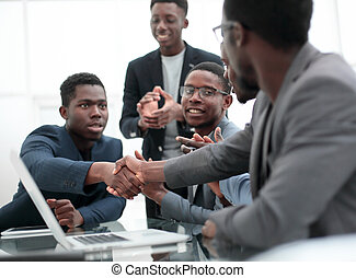 young businessman shaking hands with his business partner